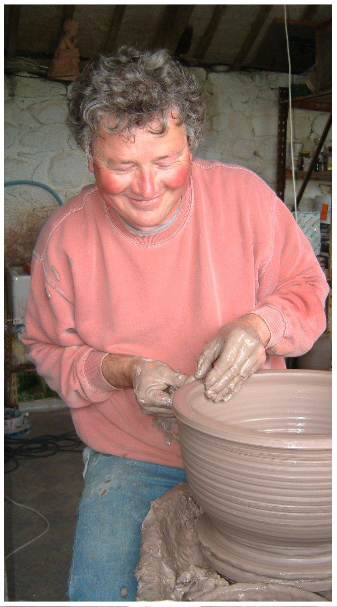 Tom Young throwing a large stoneware bowl